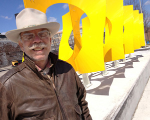 jon hudson with large fluid dynamics sculpture in Dayton, OH